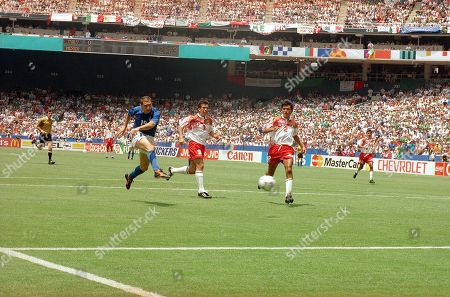 Italy's Daniele Massaro (19) kicks a second half goal past Mexico's Juan de Dios Ramirez (3) and Claudio Suarez (2) during the Italy Vs Mexico Group E World Cup match on at Washington's RFK Stadium. Italy and Mexico tied 1-1 and Mexico is advancing to the next round. Italy only placed third in Group E, making the team's fate yet uncertain