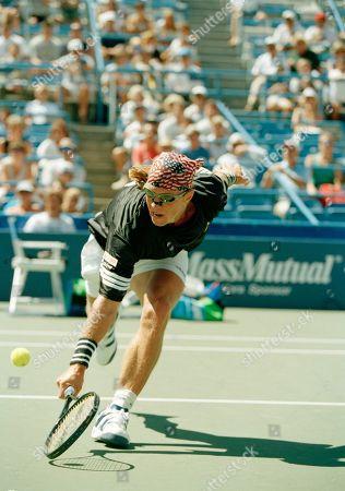 Luke Jensen Luke Jensen of Marietta, Ga., reaches to make a return towards Austria's Thomas Muster at the U.S. Open tennis tournament in New York, . Muster defeated Jensen 7-6, (7-3), 6-3, 6-0