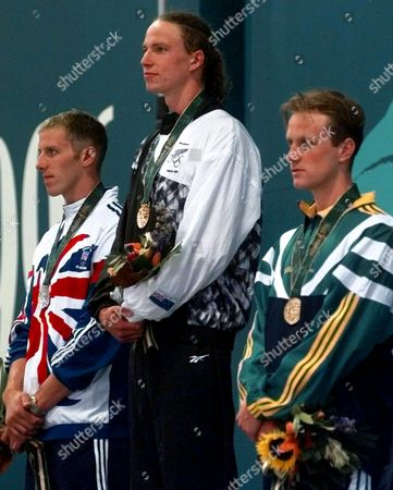 Stock Photo of PALMER LOADER KOWALSKI From left to right: Paul Palmer of Great Britain, silver, Danyon Loader of New Zealand, gold and Daniel Kowalski of Australia, bronze, during the presentation ceremony for the men's 400 meters freestyle at the1996 Summer Olympics in Atlanta
