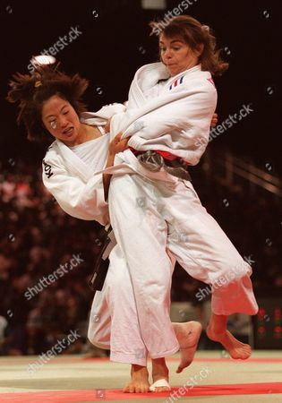 Stock Image of RESTOUX HYUN Hyun Sook-Hee, left, of Korea and Marie-Claire Restoux of France battle for the gold in the women's half-lightweight judo competition at the Olympics in Atlanta on . Restoux won the bout to take the gold