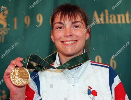 Stock Photo of RESTOUX Marie-Claire Restoux of France holds her gold medal in women's judo half-lightweight at the Summer Olympics in Atlanta, on