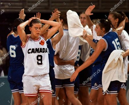 Stock Picture of EVANS Canadian guard Jodi Evans walks off the court as the Italian women's basketball team celebrates their 59-54 victory at the Olympic Games at Morehouse College in Atlanta