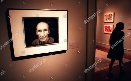 "BURROUGHS A visitor to the ""Ports of Entry: William S. Burroughs and the Arts"" exhibition walks past a 1995 portrait of an aged Burroughs by photographer Annie Liebovitz, at the Los Angeles County Museum of Art inLos Angeles"