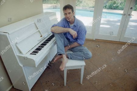Davis Gaines Actor Davis Gaines poses by his piano at his Hollywood Hills home in Los Angeles on