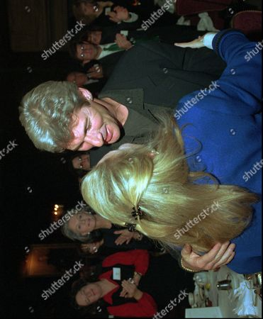 GERE FISHER Actor Richard Gere, right, embraces Mary Fisher, founder of the Family AIDS Network during a benefit for the Harvard AIDS Institute in Boston, . Gere and Fisher were honored for their leadership in the fight against AIDS