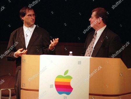 AMELIO JOBS Apple Computers Inc. co-founder Steve Jobs, left, gestures towards present chairman Gil Amelio, right, during a news conference Friday night, in Cupertino, Calif. Apple and Job's Next Software Inc. have made an agreement to revitalize Apple's operating system