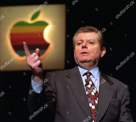 AMELIO Apple Computer Inc. chairman Gil Amelio gestures during a news conference in Cupertino, Calif., Wednesday afternoon, after Apple's shareholders meeting. Amelio, who took charge of Apple exactly a year ago, must persuade investors to keep faith in Apple despite its shrinking bottom line, market share and stock price