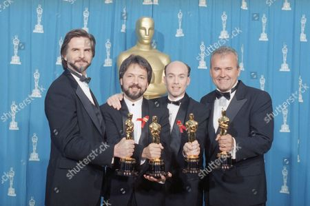 """Ken Ralson, George Murphy, Stephen Rosenbaum and Allan Hall, left to right, hold their Oscars for Visual Effects for the film """"Forrest Gump"""" backstage at the 67th Annual Academy Awards on in Los Angeles"""