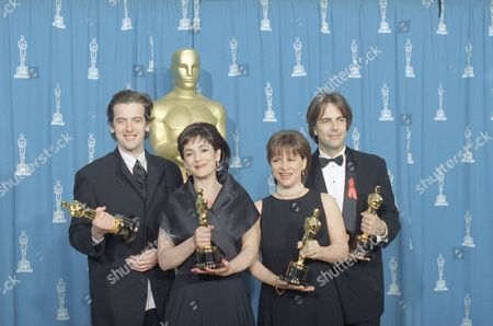 "Two pairs of winners who tied for the Oscar for Live Action Short Film pose together with their awards. They are (l-r) Peter Capaldi and Ruth Kenley-Letts for ""Frank Kafka's It's Wonderful Life,"" and Peggy Rajski and Randy Stone for ""Trevor,"" at the 67th annual Academy Awards in Los Angeles on"
