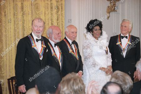 1994 Kennedy Center Honors The recipients of the 1994 Kennedy Center Honors award attend a reception in evening on in the East Room of the White House. From left to right are songwriter Pete Seeger, director Harold Prince, composer Morton Gould, singer Aretha Franklin, and actor Kirk Douglas