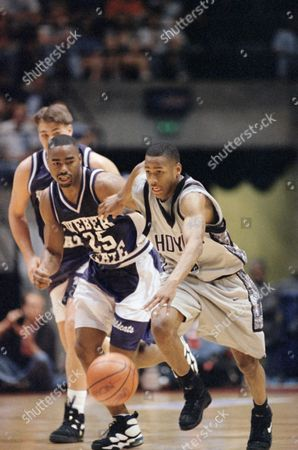 Georgetown's Allen Iverson (3) and Weber State's Ruben Nembhard (25) chase the ball during their NCAA Southeast Regional game, in the Leon County Civic in Tallahassee, Fla. Georgetown defeated Weber State 53-51 to advance to the Sweet Sixteen