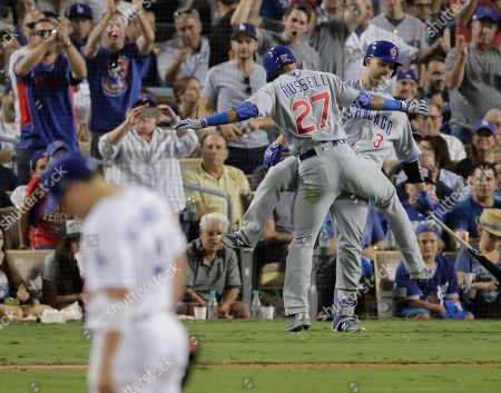 Chicago Cubs' Addison Russell celebrates his two-run home run off Los Angeles Dodgers relief pitcher Joe Blanton during the sixth inning of Game 5 of the National League baseball championship series, in Los Angeles