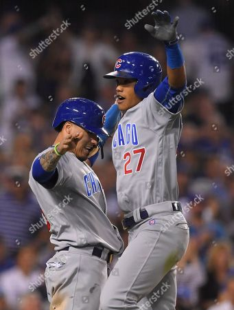 Chicago Cubs' Addison Russell celebrates his two-run home run off Los Angeles Dodgers relief pitcher Joe Blanton with teammate Javier Baez during the sixth inning of Game 5 of the National League baseball championship series, in Los Angeles