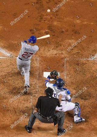 Chicago Cubs' Addison Russell hits a two-run home run off Los Angeles Dodgers relief pitcher Joe Blanton during the sixth inning of Game 5 of the National League baseball championship series, in Los Angeles