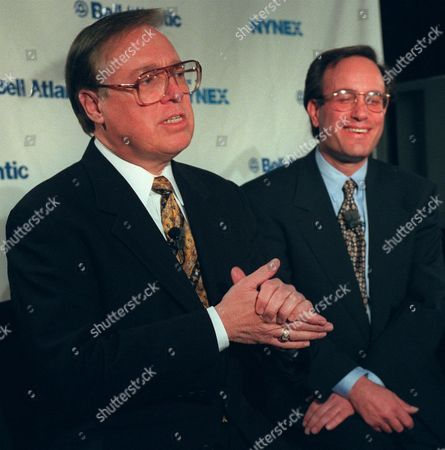 Raymond Smith, left, chairman and chief executive officer of Bell Atlantic, and Ivan Seidenberg, chairman and chief executive officer of Nynex, smile during a news conference in New York, . Bell Atlantic and Nynex agreed to the largest merger in telecommunications, a $23 billion deal that creates a colossus connecting 37 million phone lines from Maine to Virginia. Smith, 58, will run the new company at first, serving as chairman and chief executive officer. Seidenberg, 49, willbe vice chairman and will become CEO about one year after the merger is completed and then will be chairman when Smith retires. The company will be called Bell Atlantic