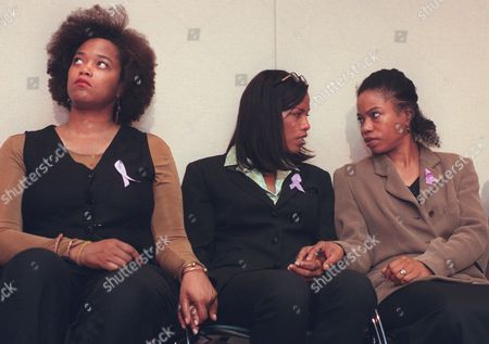 SHABAZZ Sisters Malaak Shabazz, left, Ilyasah, center, and Qubilah, comfort each other during a news conference announcing the creation of a fund to help defray the anticipated cost of rehabilitation for their mother, Dr. Betty Shabazz, in New York . The widow of Malcolm X remains hospitalized with life-threatening burns suffered in a fire police say was set by her 12-year-old grandson