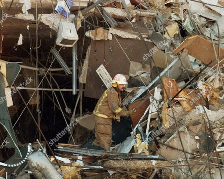 MIKE SHANNON Oklahoma City District Fire Chief Mike Shannon searches through the rubble of the bomb destroyed Alfred P. Murrah Federal Building moments after the explosion, in downtown Oklahoma City. Shannon was one of the first to arrive on scene following the terrorist attack