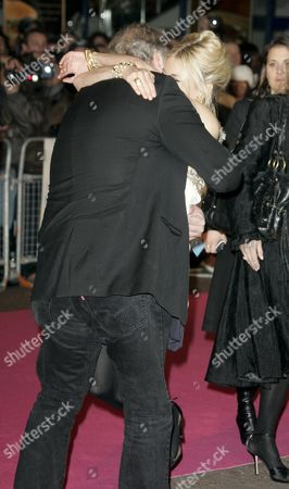 Sienna Miller hugs director George Hickenlooper