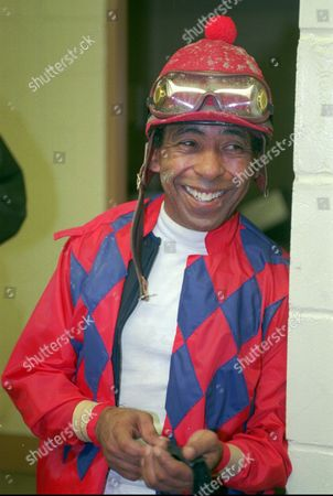 ANGEL CORDERO Jockey Angel Cordero Jr., smiles as he answers questions after riding in the second race at Belmont Park in Elmont, N.Y., in this Photo. Cordero will ride Classy Mirage in the $1 million Breeders' Cup Sprint Saturday at Belmont Park. The 52-year-old Hall of Famer promises this will be his last ride in the United States