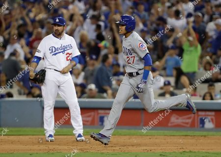 Chicago Cubs' Addison Russell rounds the bases after hitting a two-run home run off Los Angeles Dodgers relief pitcher Joe Blanton during the sixth inning of Game 5 of the National League baseball championship series, in Los Angeles