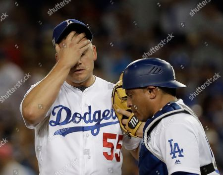 Los Angeles Dodgers' Joe Blanton reacts after giving up a two-run home run to Chicago Cubs' Addison Russell during the sixth inning of Game 5 of the National League baseball championship series, in Los Angeles