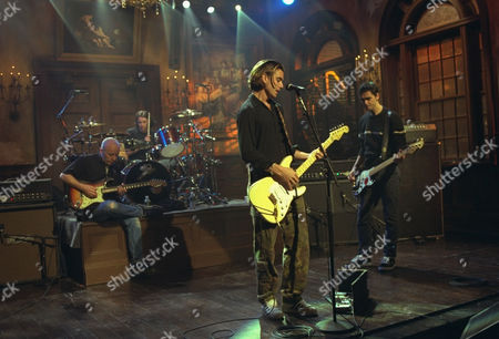 """Lead singer Gavin Rossdale, foreground, performs with the band Bush during a rehearsal for an appearance on NBC's """"Saturday Night Live,"""" in New York, . From left: guitarist Nigel Pulsford, drummer Robin Goodridge, Rossdale, and bassist Dave Parsons. Bush sold more than four million copies of its debut album in the U.S. and their new album, """"Razorblade Suitcase,"""" is being counted on to salvage a bad business year for rock 'n roll"""