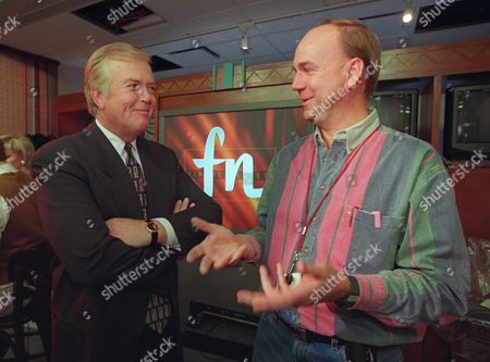 CNNFN Lou Dobbs, left, veteran CNN business news anchorman and executive in charge of shaping CNNfn's programming, listens, to Andy Parson, technical projects manager for CNN Networks, as they prepare in New York for Friday's debut of the financial news network from Turner Broadcasting System Inc