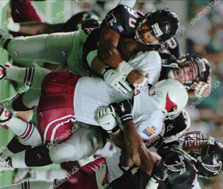 BENNETT Arizona Cardinals fullback Larry Centers (37) runs into a wall of Atlanta Falcons defense with Travis Hall (98), Chuck Smith (90) and Cornelius Bennett (97) during first half play at the Georgia Dome in Atlanta