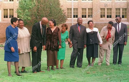 LITTLE ROCK NINE The Little Rock Nine laugh at a joke after posing for a magazine photographer on the lawn of Little Rock Central High on . They are, from left, Carlotta Walls LaNier, Melba Pattillo Beals, Terrence Roberts, Gloria Ray Karlmark, Thelma Jean Mothershed Wair, Ernest Green, Elizabeth Ann Eckford, Minnijean Brown Trickey, and Jefferson A. Thomas. The nine were the first black students in Little Rock integrated into the then all white Central High School in Sept. 1957
