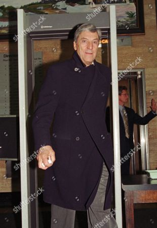 CERRUTI Italian fashion designer Nino Cerruti leaves federal court through a metal detector, in Buffalo, N.Y. Cerruti is asking a judge to stop a Buffalo-based suit maker from farming out work to factories in Costa Rica and Mexico