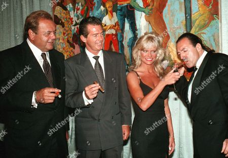 CELEB CIGARS Actors Paul Sorvino, left, and Jack Scalia, second left, watch as model Diane Hoyes light up a cigar for actor Armand Assante, right, during a cigar dinner held at the Atlantic City Hilton Hotel Casino in Atlantic City, N.J., on Saturday night