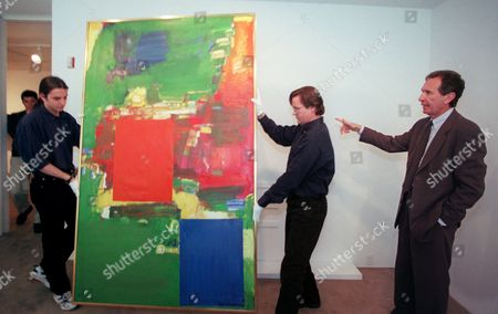 """GLIMC HER Arne Glimcher, left, chairman of PaceWildenstein, right, directs workers in the placement of the painting """"Olive Grove,"""" at the gallery in New York . The painting, by artist Hans Hofmann, is one of seven works from the CBS corporate art collection being offered for sale by PaceWildenstein. According to a gallery spokesperson Monday, April 21, 1997, """"Olive Grove"""" is expected to sell for over one million dollars"""