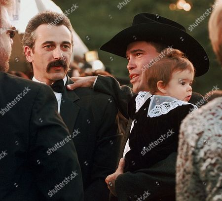 WALKER Country music performer Clay Walker holds his 8-month-old daughter, McClay, as he talks with fellow artist Aaron Tippin outside the Grand Ole Opry House in Nashville, Tenn., before the start of the Country Music Association Awards show on