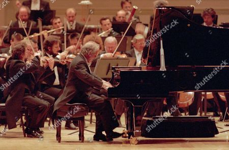 BARENBOIM MEDEROS Daniel Barenboim plays Brahms' Piano Concerto No. 1 with the Berlin Philharmonic at New York's Carnegie Hall . The pianist, who performed earlier that evening with a tango group at the Argentine Consulate, was substituting for ailing Maurizio Pollini with the orchestra