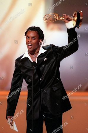"""KEVIN MAMBO Actor Kevin Mambo of """"Guiding Light"""" waves his Emmy for Outstanding Younger Actor in a Drama Series at the 23rd Annual Daytime Emmy Awards in New York"""