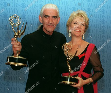 """SLEZAK KEATING Charles Keating, left, and Erika Slezak pose with their Emmys during the 23rd Annual Daytime Emmy Awards in New York . Slezak won the Outstanding Lead Actress In a Drama Series for her role in """"One Life To Live,"""" and Keating won Outstanding Lead Actor in a Drama Series for his role in """"Another World"""