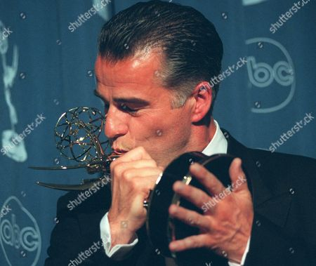 """BUCHANAN Ian Buchanan kisses the Emmy he received for Outstanding Supporting Actor in a Drama Series for his role as Dr. James Warwick in """"The Bold and The Beautiful"""" at the Daytime Emmy Awards in New York"""