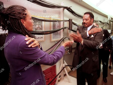 JACKSON HUNTER-GAULT Rev. Jesse Jackson, right, gets a Macarena dance lesson from Charlayne Hunter-Gault, anchor on The Newshour with Jim Lehrer, outside the show studio at the Democratic Convention in Chicago