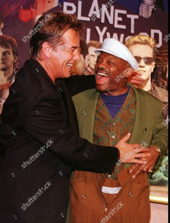 """JOHNSON BROWN Actor Don Johnson, left, embraces San Francisco's Mayor Willie Brown as Brown tries on the clothing from the """"Nash Bridges"""" series, in San Francisco. The clothes were donated by Johnson to the Planet Hollywood Restaurant during a cast party Friday night. A lawsuit was filed earlier Friday in San Francisco Superior Court claiming that Johnson fired two women from the """"Nash Bridges"""" crew after they rejected his alleged sexual advances"""