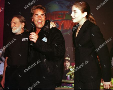 """JOHNSON NELSON O'KEEFE Actor Don Johnson, center, is joined by celebrities Willie Nelson, left and """"Nash Bridges"""" co-star Jodi O'Keefe at a cast party, in San Francisco. A lawsuit was filed earlier Friday in San Francisco Superior Court claiming that Johnson fired two women from the """"Nash Bridges"""" crew after they rejected his alleged sexual advances"""