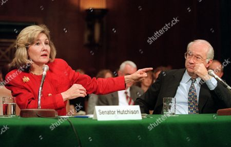 HUTCHISON GRAMM Sen. Phil Gramm, R-Texas, right, looks on as Sen. Kay Bailey Hutchison, R-Texas, gestures while testifying on Capitol Hill before the Senate Judiciary Committee hearing on drugs and the erosion of America's borders