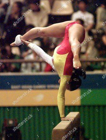 LIU XUAN Liu Xuan of China keeps her balance with hew right arm on the balance beam during women's team competition at the East Asian Games in Pusan, southern South Korea, . Chinese team won the event