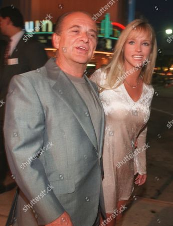 """PESCI WALLACE Actor Joe Pesci, left, arrives at the world premiere of his new movie """"Eight Heads In A Duffel Bag"""" with Leighanne Wallace in the Westwood section of Los Angeles . The comedy has Pesci faced with an unusual twist on the frequent flyer's pesky problem of identical luggage switched at an airport baggage claim"""