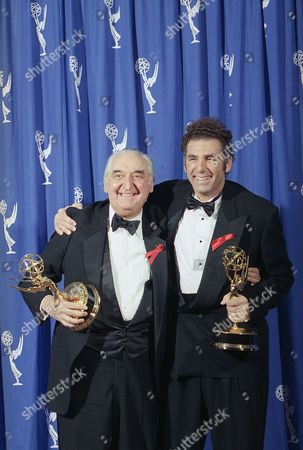 """Best Supporting Actors Fyvush Finkel, left, and Michael Richards hug while posing for the media backstage for the 46th annual Primetime Emmy Awards in Pasadena, Calif., . Finkel won for the CBS dramatic series, """"Picket Fences,"""" and Richards won for the NBC comedy series, """"Seinfeld"""