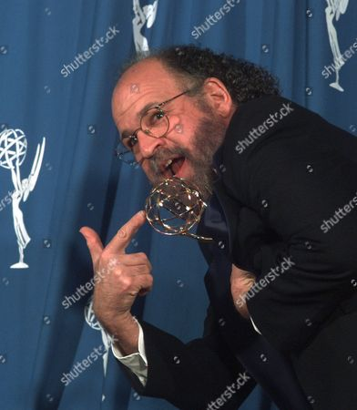 "KAGAN Jeremy Kagan clowns for the cameras after winning his Emmy for outstanding direction in a drama series for an episode of ""Chicago Hope"" at the 48th Annual Primetime Emmy Awards in Pasadena, Calif"