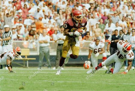 Stock Photo of Henry Ellard, Kevin Rose Washington Redskins wide receiver Henry Ellard, left, runs past Atlanta Falcons safety Kevin Ross (36) on a 73-yard pass reception from Redskins quarterback John Friez for a second quarter touchdown at Washington's RFK Stadium