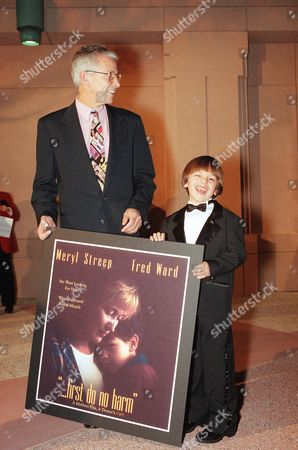 Director-producer Jim Abrahams, left, poses with Seth Adkins at the premiere of ?...First Do No Harm,? in Los Angeles. Meryl Streep stars in the made-for-TV movie along with Fred Ward and Seth Adkins