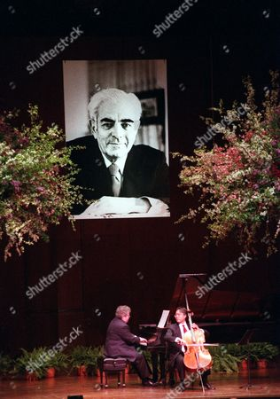 Ax Ma American pianist Emanuel Ax and cellist Yo-Yo Ma perform under a large portrait of Avery Fisher during a benefit concert given in honor of the late philanthropist in the music hall named after him in New York's Lincoln Center