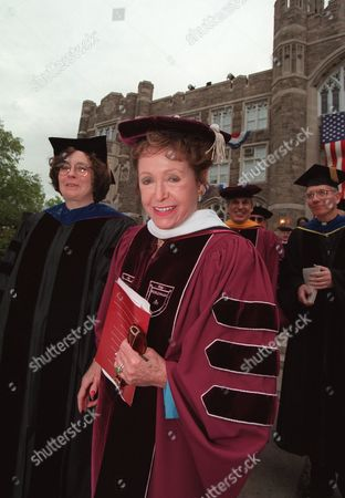 CLARK FORDHAM Writer Mary Higgins Clark walks with members of the faculty of Fordham University, in New York after receiving an honorary doctorate of letters and delivering the commencement address