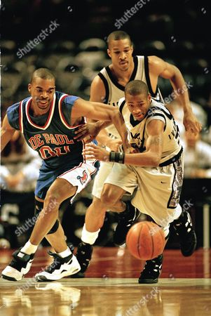 59263.JPG Georgetown's Allen Iverson, right, races DePaul's Will Macon (00) to the loose ball as Georgetown's Don Reid looks on in the first half in Landover, Md